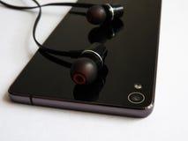 有美好的设计的手机耳机 库存图片