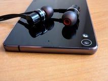 有美好的设计的手机耳机 免版税库存照片