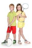 有羽毛球拍的孩子 免版税图库摄影