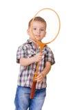 有羽毛球拍的男孩在白色 免版税图库摄影