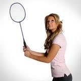 有羽毛球球拍的妇女 免版税库存照片