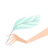 有羽毛的手 免版税图库摄影