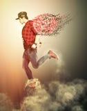 有翼的现代天使男孩走在云彩的 青年力量 免版税库存照片