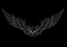 有翼的纹身花刺头骨在黑色 免版税库存照片