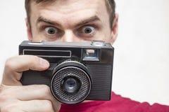 有老照相机的人 免版税库存照片