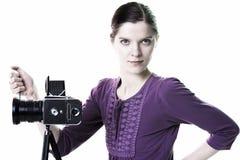 有老照相机的妇女 库存照片