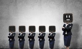 有老电视的女商人而不是头 库存照片