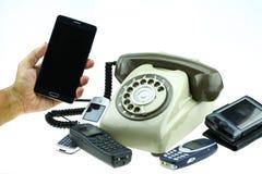有老电话的新的巧妙的电话在白色背景 新的通讯技术 免版税库存图片