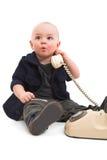 有老电话的男孩 免版税库存图片