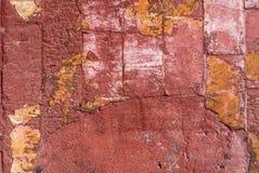有老膏药的混凝土墙切削了纹理背景 免版税库存图片