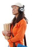 有耳机和书的偶然学生 免版税图库摄影