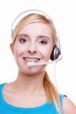 有耳机和话筒耳机的女孩在白色 免版税库存照片