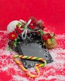 有耳机最佳的圣诞节礼物的片剂 免版税库存图片