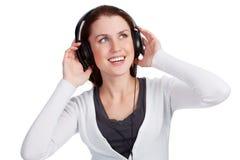 有耳机的十几岁的女孩 免版税库存图片