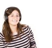 有耳机的十几岁的女孩 免版税图库摄影