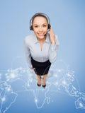 有耳机的友好的女性热线服务电话操作员 免版税库存图片