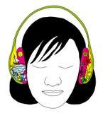 有耳机的女孩 免版税库存照片