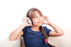 有耳机的女孩 免版税图库摄影