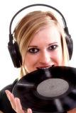 有耳机的妇女听到音乐的查出 库存照片