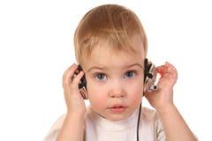 有耳机的婴孩 免版税库存照片