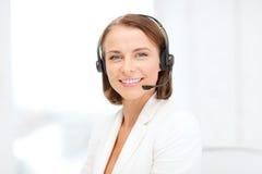 有耳机的微笑的女性热线服务电话操作员 库存图片