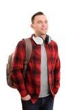 有耳机的微笑的男学生 库存图片