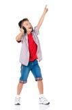 有耳机的愉快的男孩 免版税库存照片