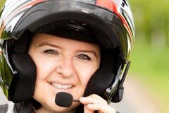 有耳机的摩托车骑士 免版税库存照片