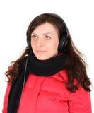 有耳机的美丽的少妇 免版税库存照片