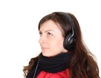 有耳机的美丽的少妇 免版税图库摄影
