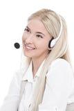 有耳机的被隔绝的白肤金发的经理 免版税库存图片