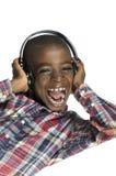 有耳机的非洲男孩听到音乐的 图库摄影