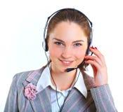 有耳机的年轻女商人 免版税库存照片
