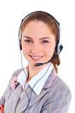 有耳机的年轻女商人 库存图片
