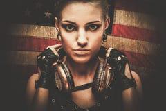 有耳机的Steampunk女孩 免版税图库摄影
