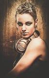 有耳机的Steampunk女孩 图库摄影