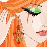 有耳环的红发女孩 库存照片