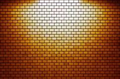 有聚光灯的橙色砖墙 免版税图库摄影