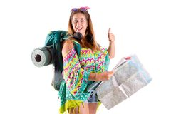 有背包和地图的旅行的女孩 库存照片