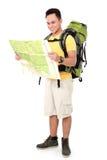 有背包和地图的男性远足者 库存图片