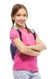 有背包的愉快的微笑的女小学生 库存照片