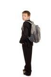有背包的男小学生在空白背景 库存图片