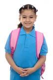 有背包的年轻学校女孩 免版税库存图片