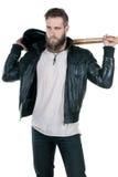 有胡子的一个吸引人人拿着一把电吉他,在白色被隔绝的背景 垂直的框架 图库摄影