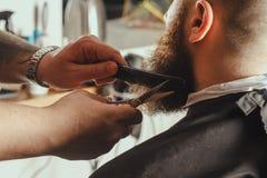 有胡子的人在理发店 库存图片