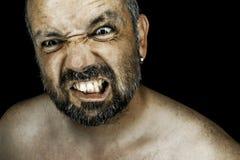 有胡子的恼怒的人 库存照片