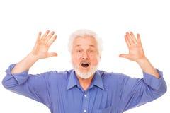有胡子的恼怒的年长人 免版税库存图片