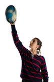 有胳膊的女运动员提高了拿着橄榄球球 免版税库存照片