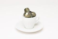 有胶囊的咖啡杯 图库摄影