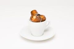 有胶囊的咖啡杯 库存图片